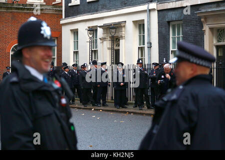 London, UK. 12th Nov, 2017. Police officers are pictured in Downing Street on their way to the Remembrance Sunday - Stock Photo