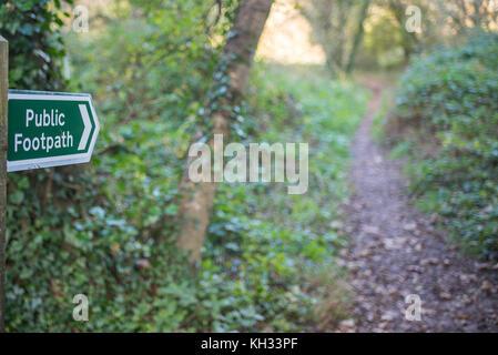 Public footpath sign in Devon woodland - Stock Photo