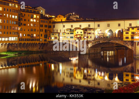 River Arno and Ponte Vecchio in Florence, Italy - Stock Photo