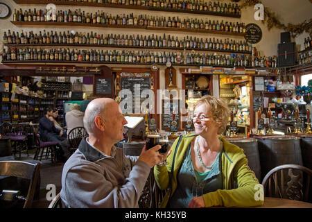 couple in Allanwater Brewhouse, Bridge of Allan, Scotland, Great Britain - Stock Photo