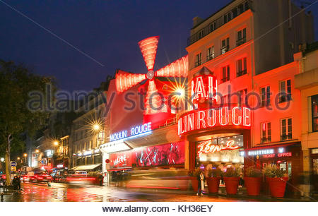 The Moulin Rouge by night, Paris, France. It is a famous cabaret built in 1889, locating in the Paris red-light - Stock Photo