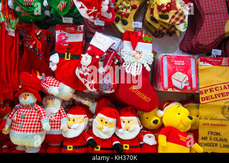 christmas gifts and decorations on sale in a shop - Stock Photo