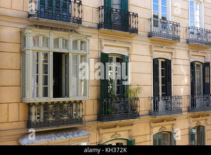 Spanish andalusian style facade, with shutters and balcony, Malaga, Spain - Stock Photo