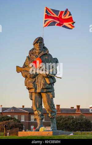 Royal Marine 'Yomper' statue at the former Royal Marines Barracks, Eastney, Portsmouth, UK on Remembrance Sunday, - Stock Photo