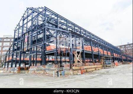 Empty warehouse/factory steel shell under construction. - Stock Photo