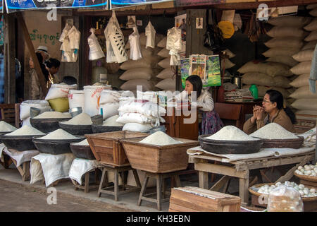Burmese women selling rice on a market stall in the ancient city of Bagan in Myanmar (Burma). - Stock Photo