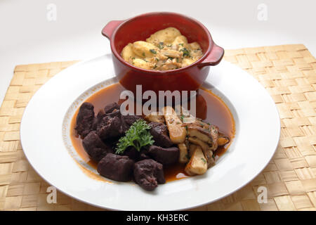 Wildragout mit Gnocchi und Steinpilzen - Stock Photo