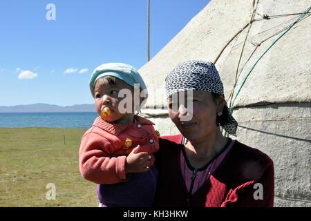 Kyrgyzstan,Song Kul lake,mother and son - Stock Photo