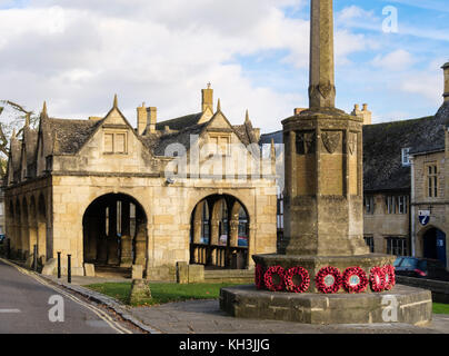 The War memorial with poppy wreathes by old 17th century Market Hall in historic Cotswolds village of Chipping Campden, - Stock Photo