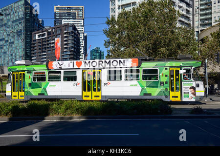 Green and white liveried tram within the Central Business District of Melbourne, Victoria, Australia - Stock Photo