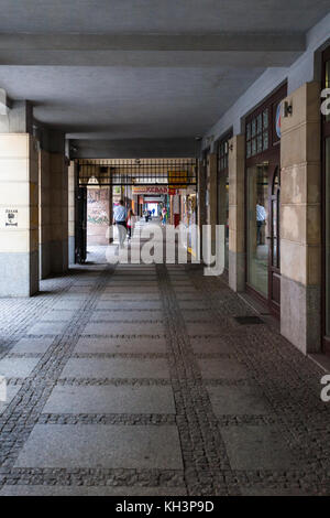WROCLAW, POLAND - SEPTEMBER 12, 2017: people in arcade in Wroclaw city in autumn. Wroclaw is the largest city in - Stock Photo