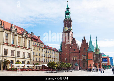 WROCLAW, POLAND - SEPTEMBER 12, 2017: tourist near tower of City Hall on central Market Square (Rynek) in Wroclaw. - Stock Photo