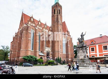 WROCLAW, POLAND - SEPTEMBER 12, 2017: tourists near John of Nepomuk ( St John Nepomucen) monument on square of Collegiate - Stock Photo
