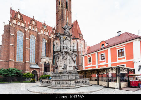 WROCLAW, POLAND - SEPTEMBER 12, 2017: people near John of Nepomuk ( St John Nepomucen) monument on square of Collegiate - Stock Photo