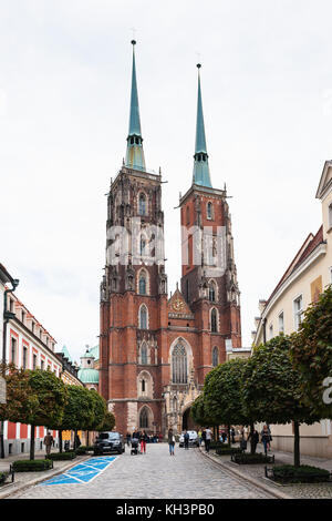 WROCLAW, POLAND - SEPTEMBER 12, 2017: people near Breslauer Dom (Cathedral of St John the Baptist) in Ostrow Tumski - Stock Photo