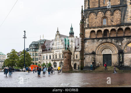 BREMEN, GERMANY - SEPTEMBER 16, 2017: people near Bismarck monument and Cathedral on Bremer Marktplatz (Bremen Market - Stock Photo