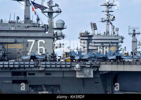 The aircraft carriers USS Ronald Reagan (CVN 76) and USS Nimitz (CVN 68) transit the Western Pacific - Stock Photo
