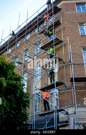 Scaffolders working on a building in Bristol - Stock Photo
