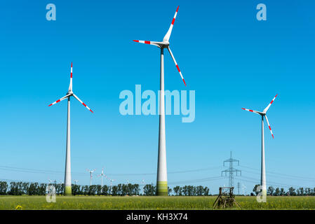 Wind power station in the fields seen in rural Germany - Stock Photo