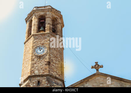 Bell tower of the church of Saint Vincent de Sarria, Barcelona, Spain - Stock Photo