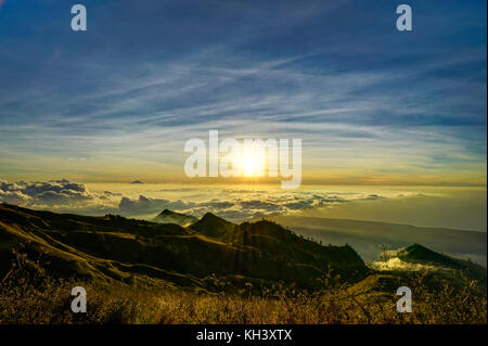 Sunset over Clouds mountain top vulcano Rinjani Lombok Indonesia - Stock Photo