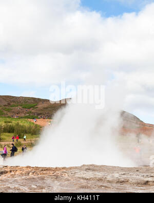Steam rises from Strokkur, a geysir in the Geothermal Field, Haukadalur in Iceland and a part of the popular Golden - Stock Photo