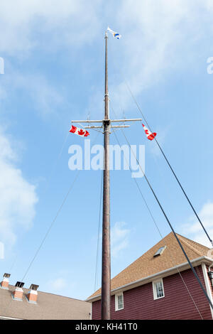 Ship's Mast.  A ship's mast with flags can be found on the waterfront at Halifax, Nova Scotia in Canada. - Stock Photo