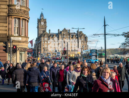 Busy pedestrian crossing on Princes Street in central Edinburgh, Scotland, United Kingdom,. - Stock Photo
