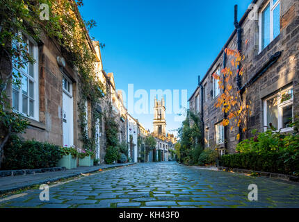 View along traditional row of mews houses towards St Stephen's Church  in Circus Lane in Stockbridge district of - Stock Photo
