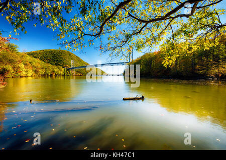 Eastward Low Angle View of the Bear Mountain Bridge, Montgomery, New York - Stock Photo