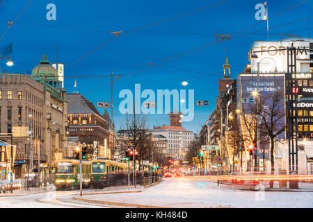 Helsinki, Finland - December 7, 2016: Tram Departs From A Stop On Mannerheim Avenue In Helsinki. Night View Of Mannerheim - Stock Photo