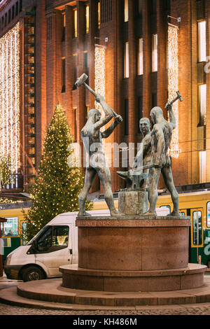Helsinki, Finland - December 7, 2016: Night View Of Famous Sculpture Group Three Smiths Statue In Evening Or Night - Stock Photo