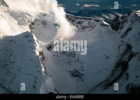 Mount Redoubt and Redoubt Volcano has an elevation of 10,197 feet above sea level.  Its located in Lake Clark National - Stock Photo