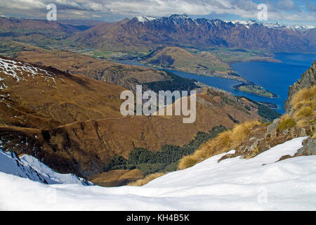 View over Queenstown and Lake Wakatipu from the slopes of Ben Lomond - Stock Photo