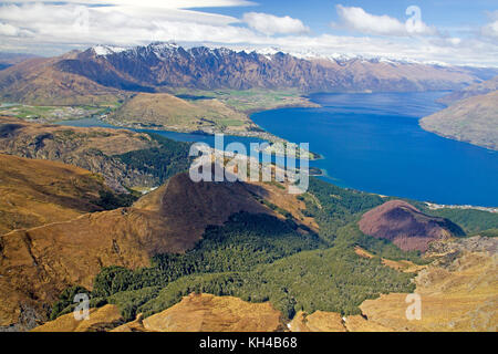 View over Queenstown and Lake Wakatipu from Ben Lomond - Stock Photo
