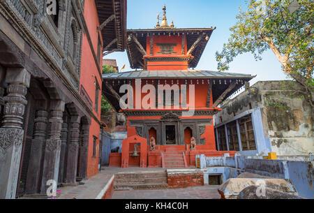 Ancient temple with intricate artwork of Hindu deities at Varanasi India - Stock Photo