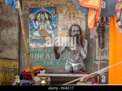 Varanasi sadhu baba covered in ash at the Ganga river bank Varanasi India - Stock Photo