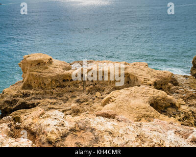 Reef formation from sandstone on the coast of Carvoeiro in southern Portugal - Stock Photo