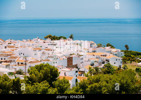 Mediterranean architecture - white color houses in Nerja, Malaga Province, Andalusia, Spain - Stock Photo