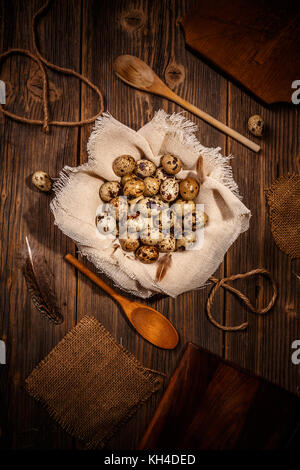 Top view of quail eggs on wooden background - Stock Photo
