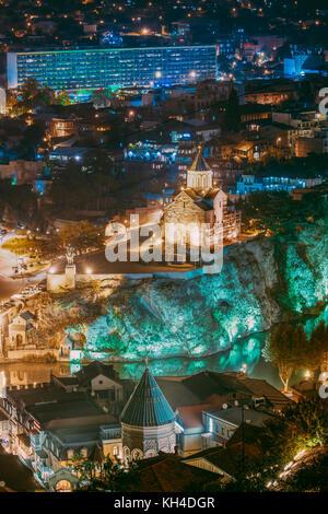 Tbilisi, Georgia. Night Evening Illuminated View Of Metekhi Church And Equestrian Statue Of King Vakhtang Gorgasali - Stock Photo