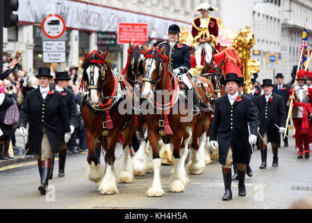 Lord Mayor's gold state coach and escort at the Lord Mayor's Show Procession Parade along Cheapside, London. Crowds - Stock Photo