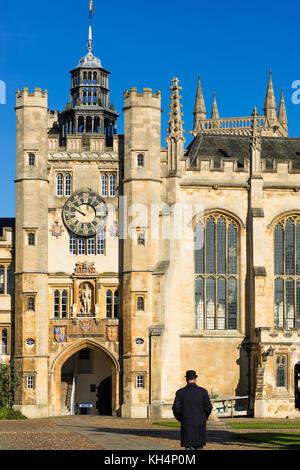 Porter walking away at Trinity College Great Court at Cambridge University. Cambridgeshire England UK - Stock Photo