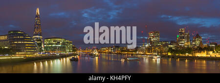 London - The panorama of riverside and skyscrapers at dusk. - Stock Photo