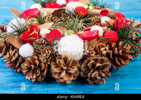 Christmas wreath on blue background - Stock Photo
