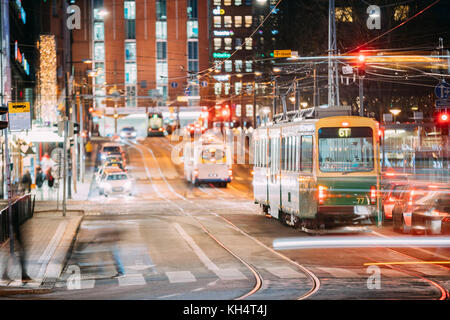 Helsinki, Finland. Tram Departs From A Stop On Kaivokatu Street In Helsinki. Night View Of Kaivokatu Street In Kluuvi - Stock Photo