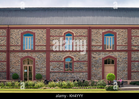 Barossa Valley, Australia - January 16, 2016: People sitting near Chateau Tanunda vintage winery on a day. It was - Stock Photo