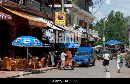 Tourists walking in the Pub street (Bar Street) area of Siem Reap in the day time. Cambodia - Stock Photo