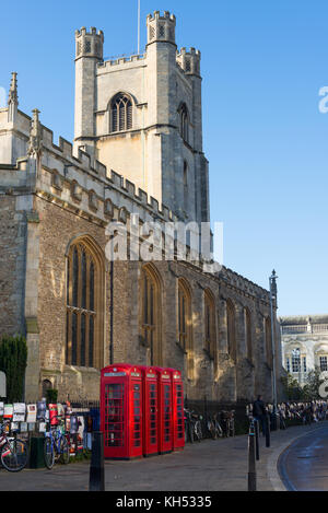 Old style British telephone booths by Great Saint Mary church in the University city of Cambridge, UK. - Stock Photo