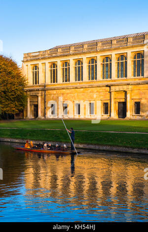 Scenic view of the Wren Library at sunset, Trinity College, Cambridge University; with punting in front on the river - Stock Photo